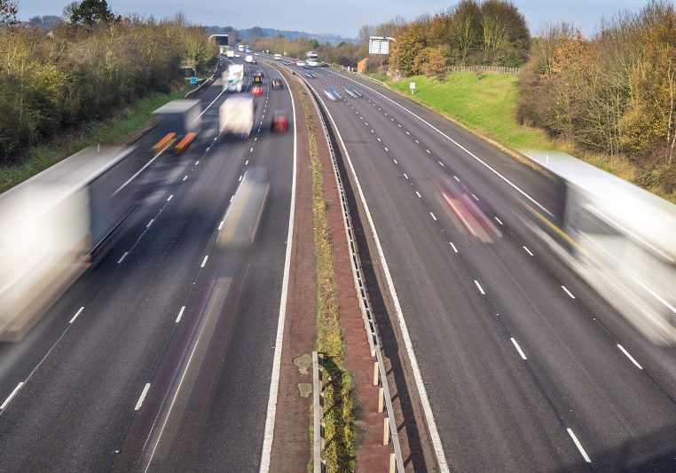Speeding traffic on an English motorway with long exposure for motion blur